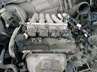 Мотор лансер цедия 1.5