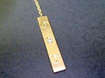 Золотая подвеска с бриллиантом Cartier Love